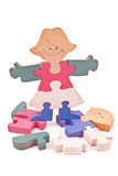 Colorful wooden girl and boy puzzle pieces Stock Photos