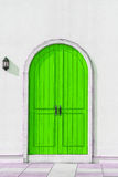 Colorful wooden green door and Detail of house exterior Stock Photos