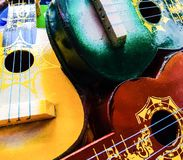 Colorful wooden guitars. An up close photo of a collection of colorful wooden guitars royalty free stock photo