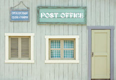 Colorful wooden house. Of the post office Stock Image