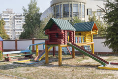 Colorful wooden house with slider on empty playground Stock Photos