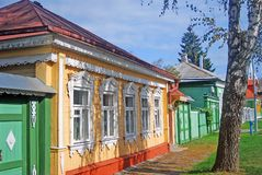 Colorful wooden houses. Kremlin in Kolomna, Russia Stock Photos
