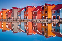 Colorful wooden houses near water Stock Photos
