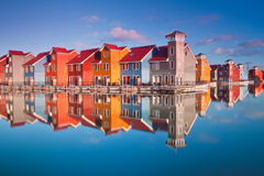 Colorful wooden houses near water Stock Images