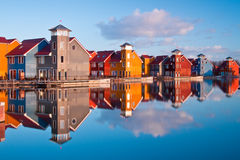 Colorful wooden houses near water Royalty Free Stock Photos