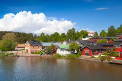 Colorful wooden houses on river coast. Porvoo Stock Photos