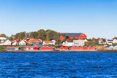 Colorful wooden houses on sea coast. Brekstad Stock Photography