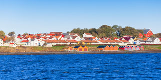 Colorful wooden houses on sea coast, Norway Royalty Free Stock Photos