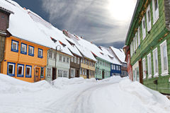 Colorful wooden houses snowed in Royalty Free Stock Image