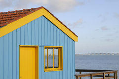 Colorful Wooden Hut. Brightly painted wooden hut overlooking the sea Royalty Free Stock Images
