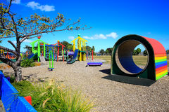 Colorful wooden Kids playground tunnel. Levin,  New Zealand Stock Photo