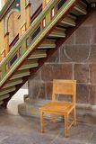 Colorful wooden ladder and a chair Royalty Free Stock Image