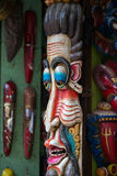 Colorful wooden masks and handicrafts on sale at shop in the Thamel District of Kathmandu, Nepal. Stock Images