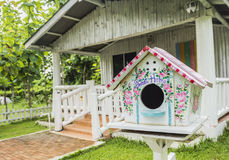 Colorful wooden nesting box. In front of the house Royalty Free Stock Photos