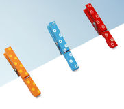 Colorful wooden pegs Stock Images