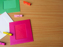 Colorful wooden pegs with colorful picture frame Royalty Free Stock Photos