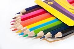 Colorful wooden pencils in the carton box Stock Photos
