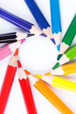 Colorful wooden pencils in the circle  on white Royalty Free Stock Image