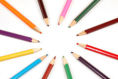 Colorful wooden pencils in circle Royalty Free Stock Images