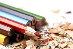 Colorful wooden pencils. Different than other. Creative mess on the table cartoonist. Wooden crayons Stock Photos