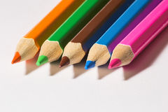 Colorful wooden pencils indoor macro. Royalty Free Stock Photography