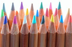 Colorful wooden pencils used by children during the drawing less stock image