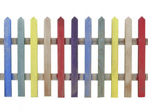 Colorful wooden picket fence isolated. Section of an old colorful wooden picket fence.  Isolated on white Royalty Free Stock Photo