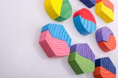 Colorful pieces of a logic puzzle. Colorful wooden pieces of a logic puzzle Royalty Free Stock Image