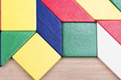 Colorful wooden pieces for tangram technique Stock Images