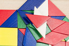 Colorful wooden pieces for tangram technique Royalty Free Stock Photo