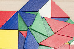 Colorful wooden pieces for tangram technique Stock Photos