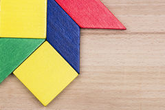 Colorful wooden pieces for tangram technique Royalty Free Stock Images