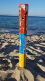 Colorful pole on beach Royalty Free Stock Photo