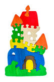 Colorful wooden puzzle pieces in castle shape Royalty Free Stock Photo