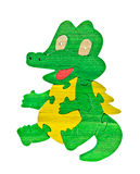 Colorful wooden puzzle pieces in crocodile shape Stock Images