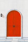 Colorful wooden red door and Detail of house exterior Royalty Free Stock Photography