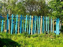 Colorful wooden rural fence. In soft blue colors Stock Images
