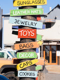 Colorful wooden signs for souvenir stores selling toys bags, hat Stock Photo