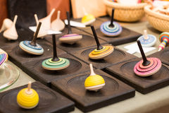Colorful wooden spinning top. On market stall Stock Photo