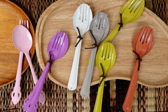 Colorful wooden spoon and forks Stock Photos
