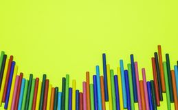 Colorful wooden sticks lay on yellow background stock image