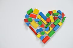 Colorful wooden toy blocks as heart Royalty Free Stock Photos