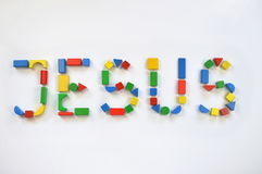 Colorful wooden toy blocks lettering JESUS Royalty Free Stock Photo