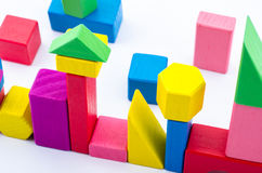 Colorful Wooden Toy Building Blocks. Lined up in creative design Royalty Free Stock Photography