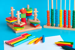 Colorful wooden toy building blocks toys on blue Royalty Free Stock Photography