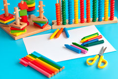Colorful wooden toy building blocks toys on blue. Stock Images