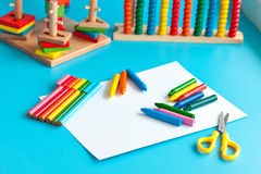 Colorful wooden toy building blocks toys on blue Stock Photos