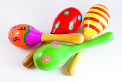 Colorful wooden toy maracas. Music percussion instrument on white background royalty free stock photo