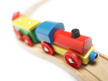 Colorful wooden toy train detail isolated on white. Horizontal stock photography
