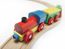 Colorful wooden toy train detail isolated on white. Horizontal royalty free stock image